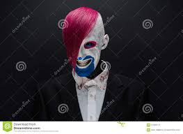 halloween theme background clown and halloween theme scary clown with pink hair in a black