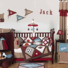 baby themes for a boy white wall themes with flag paint combined by brown wooden cradle