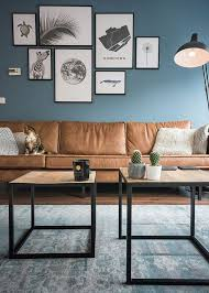 Color Schemes For Living Rooms With Brown Furniture by Chic Seating Area With A Brown Sofa And A Navy Accent Wall And