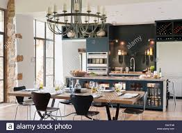 Kitchen Diner Tables by Verdigris Chandelier Hangs Above An Oak Topped Dining Table In