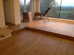 White Laminate Floor Tiles Wooden Laminate Flooring With White Ceramic Wall Tile Also Bathtub