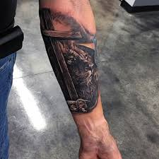 tattoo cross forearm lion and lamb under big wooden cross religious realistic forearm