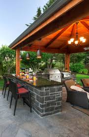 patio kitchen design outside kitchen with grill and stone corner fireplace under the