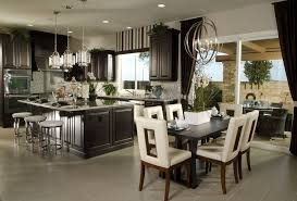 modern great room with recessed lighting u0026 pendant light in san