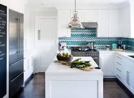 blue chevron ceramic tile backsplash installed in the kitchen with