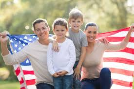 A American Flag Pictures American Family Of Four Proudly Holding An American Flag Smiling