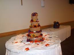 unsmooth buttercream wedding cake with fall flowers and leaves