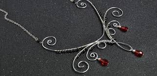 silver wire necklace images How to make a silver wire wrapped necklace with red drop glass jpg