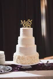 wedding cake icing purple kansas ballroom wedding gold cake topper gold cake and