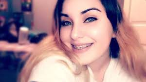 14 year old kills herself in front of family after being