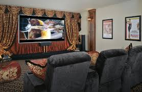 alluring home movie theater rooms with black suede sofa and red