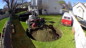 timelapse footage of an in ground trampoline being installed in a