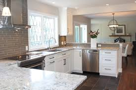 snow white quartz countertop on painted white cabinets north