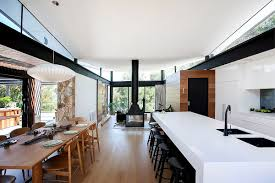 house in stone glass and steel overlooking the yarra river kitchen and dining region of the warrandyte residence in victoria