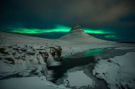 iceland kirkjufell mountain volcano rock waterfall snow night