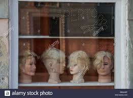 barber shop and mannequin head window display venice italy stock