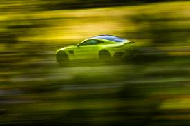 lime green aston martin check out all the pictures and stats on the all new aston martin