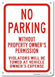 no parking sign violators will be towed away at vehicle owners
