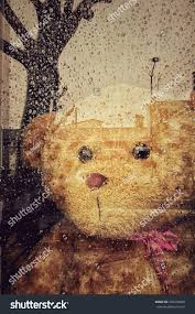 teddy bear writing paper sad teddy bear looking out window stock photo 359479868 shutterstock sad teddy bear looking out of the window in a rainy days