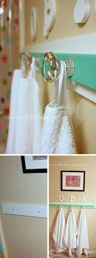 bathroom towel hook ideas towel hooks add small frames above the hooks spray paint white