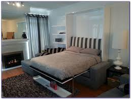 murphy bed with couch in front bedroom home design ideas