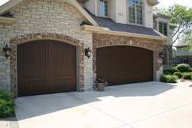 carriage house garage doors faux wood french country style garage