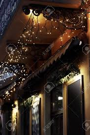 luxury decorated store front with garland lights in european stock