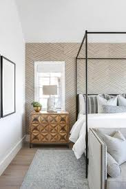 taupe chevron wallpaper on accent wall transitional bedroom