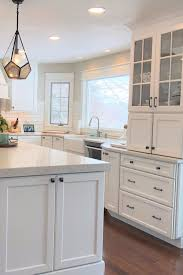 white kitchen cabinets this timeless white kitchen features an abundance of stylish