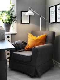 black corner reading chair with white floor lamp