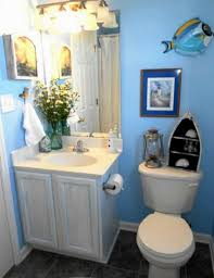 kids bathroom designs in white and blue theme with brown floor