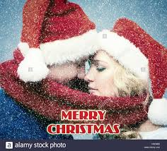 lovely christmas couple in santa claus hats stock photo royalty