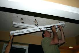 how to remove fluorescent light fixture and replace it fluorescent light replacement staggering replace fluorescent light