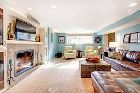 light blue living room with leather furniture set beige carpet light blue living room with leather furniture set beige carpet floor tv and fireplace