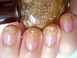 simple gold glitter gradient christmas nails of faces and fingers