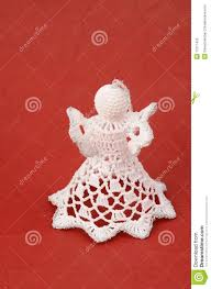 handmade angel christmas ornament on red backgroun royalty free