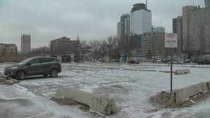 city of edmonton to consider converting parking lots into downtown