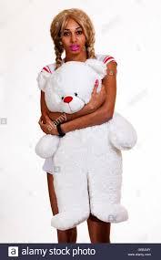 slim african american girl standing stock photos slim african skinny african american woman holding teddy bear stock image
