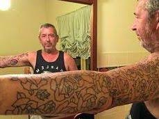 he has had 65 roses tattooed on his arm all for a good cause