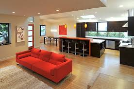 decorating open plan kitchen with orange bar table and black bar