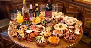 table full of food the best tapas bars in barcelona barcelona home blog