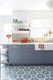 recycled countertops blue gray kitchen cabinets lighting flooring