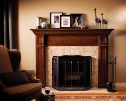 Wooden Fireplace Mantels Decoration With Frame And Brown Sofa