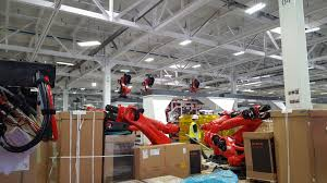 bmw factory robots 467 kuka robots shipped to model 3 factory ahead of production