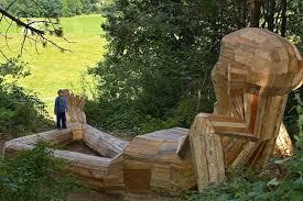 wood sculptures in copenhagen are treasure hunt of recycled
