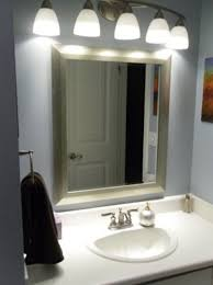 bathroom green sunbrust resin lights above mirror lodge leaning