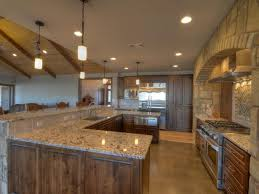 aspen kitchen island rustic kitchen with pendant light u0026 concrete floors in llano tx