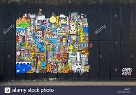 colourful mural painting by french street artist grems on a wall colourful mural painting by french street artist grems on a wall in the southbank centre near