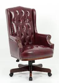 chairman classic swivel armchair faced in soft burgundy or green
