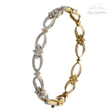 traditional design design diamond studded pair of bangles in 18kt gold